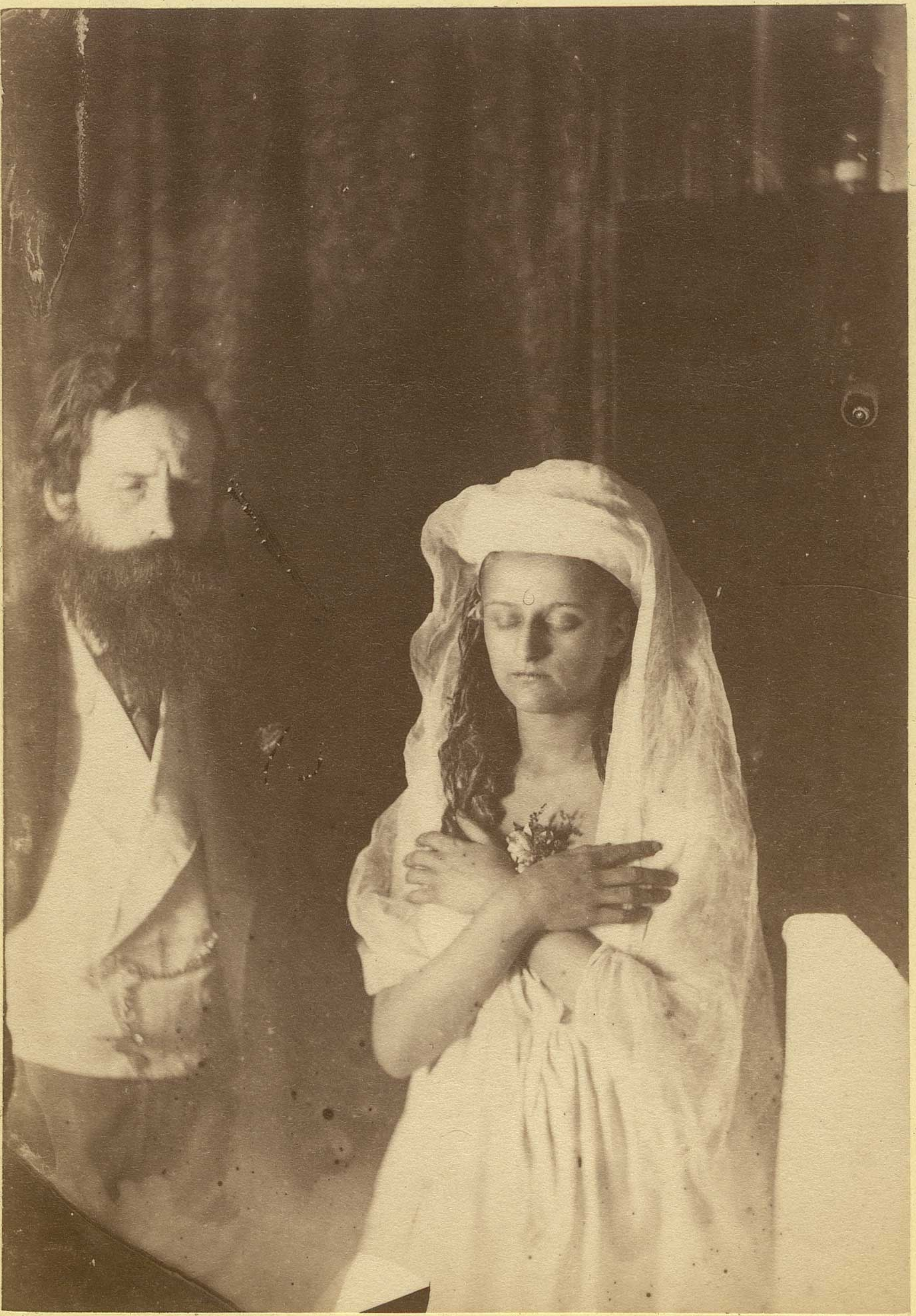 aged photograph of a woman and a man
