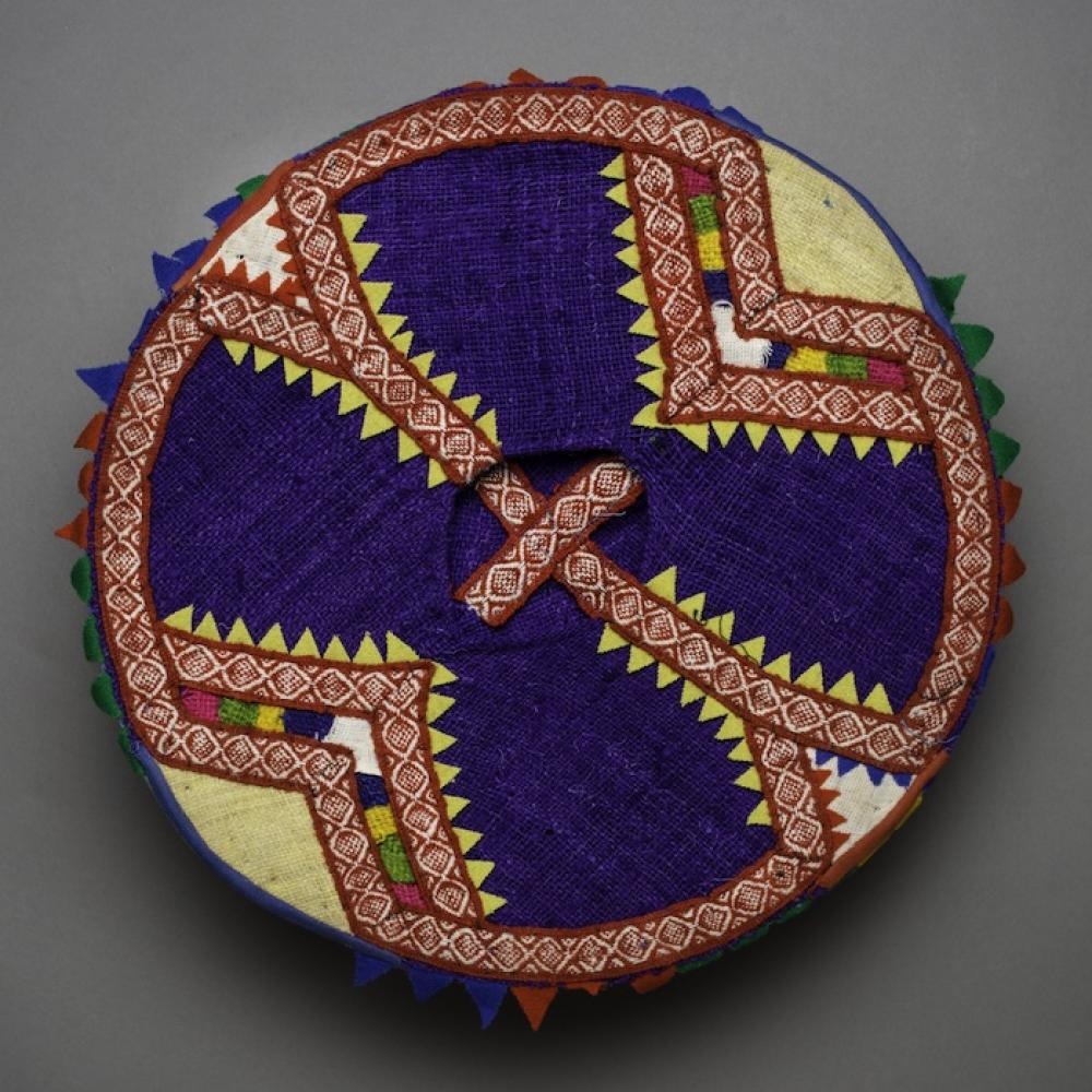woven hat of red, purple, white and orange