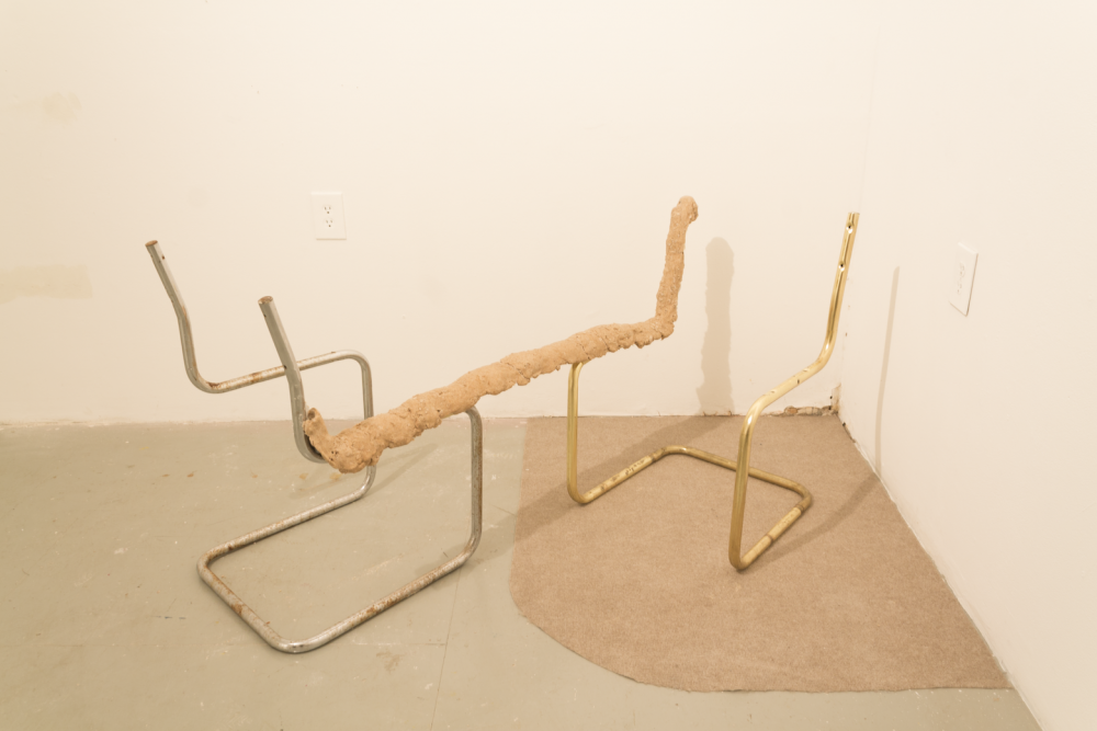image of chair frames fused together with pink foamy clay