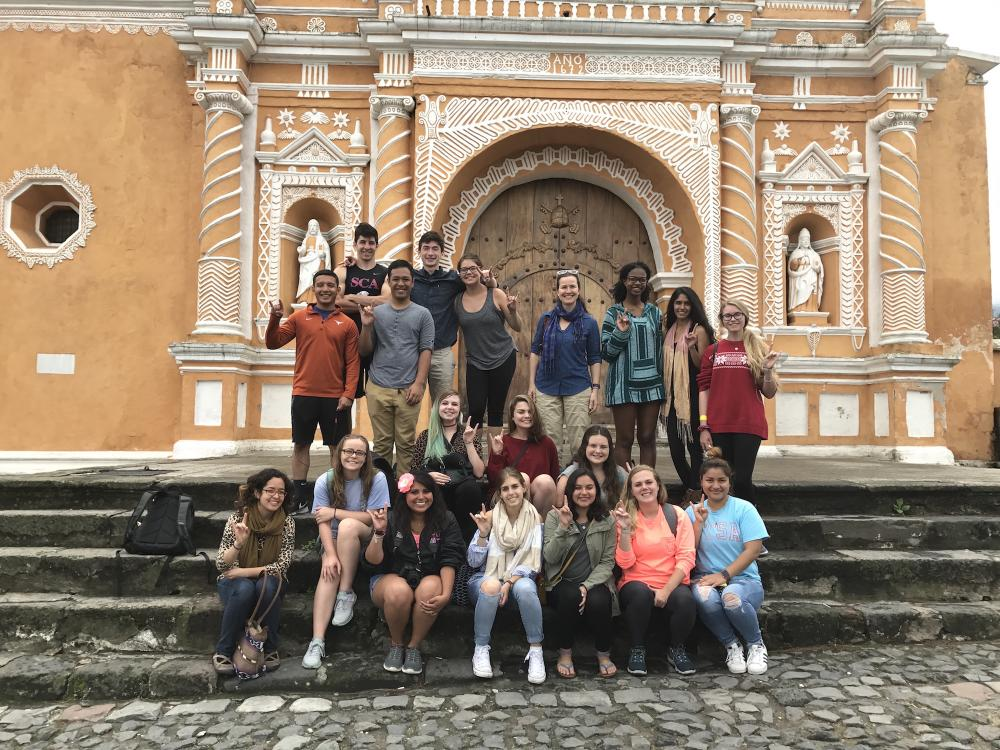 image of group of students and professor in front of belize site