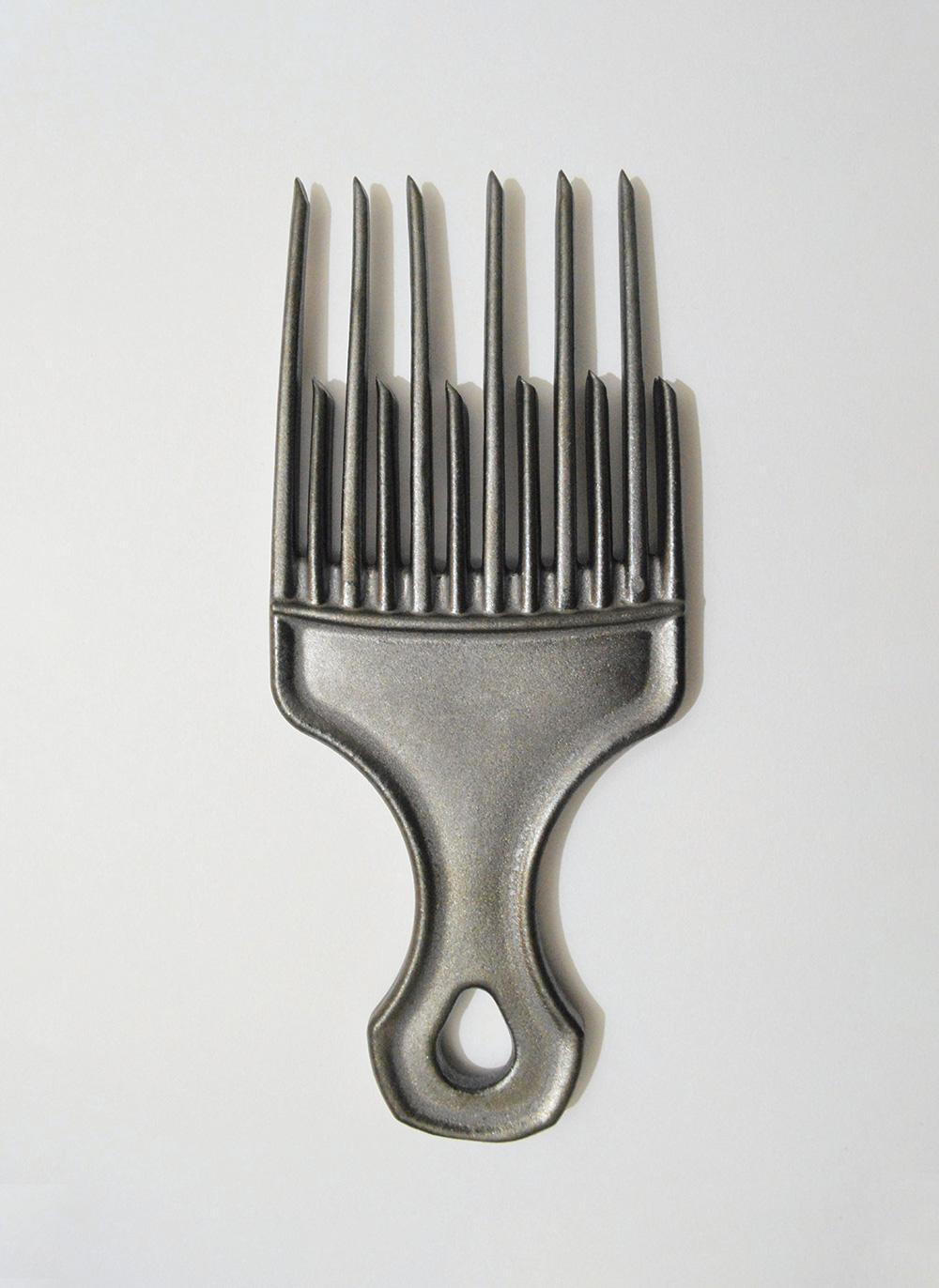 altered hair comb cast in metal