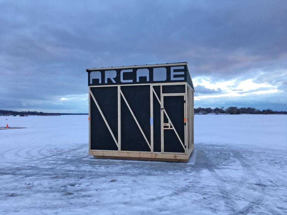 outdoor ice shed with handmade sign that reads Arcade depicted in documentation of work from Kyle Peets