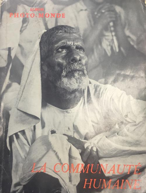 image of man looking up toward the sky in a photo-album cover