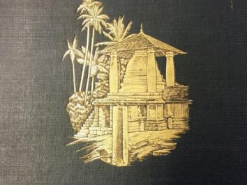 book cover with gold foil boat