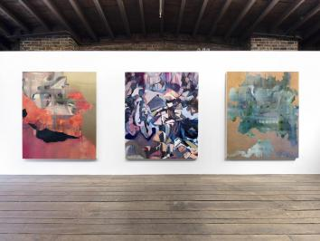 three large canvases awash in mauves and pinks installation image