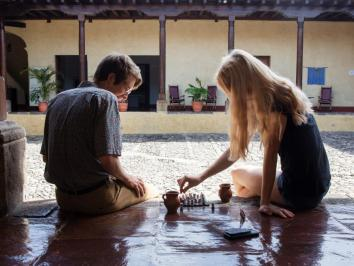 Two UT students play chess in the commons area of Casa Herrera, the research center based out of Guatemala