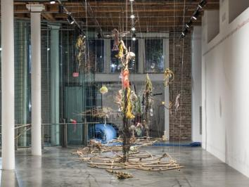 installation view of multiple items strung in space
