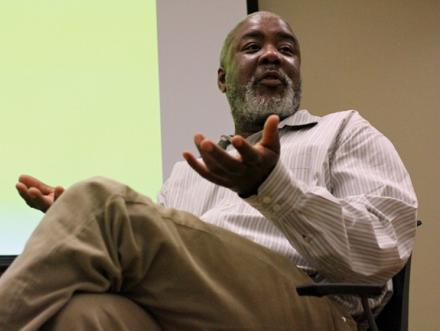 dr Eddie Chambers addressing an unseen audience on a panel