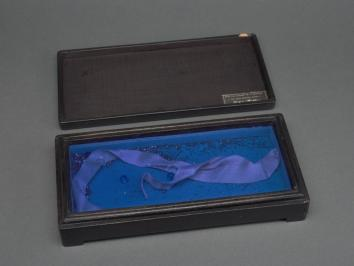 piece from Joseph Cornell involving a small box with interior blue velvet lining in story in Panorama