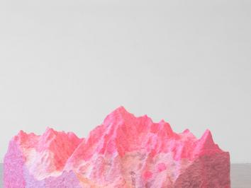 Organic Rock in fuchsia and pink monotones set in front of gray backdrop.