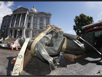 A Civil War monument statue is strapped to the back of a flatbed after it was toppled from its pedestal in front of the State Capitol to illustrate an opinion piece by University of Texas at Austin Art History Professor Eddie Chambers piece