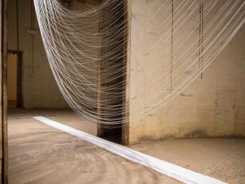 image of string suspended in silo in one large swoop
