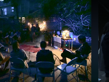 images of group gathering at night