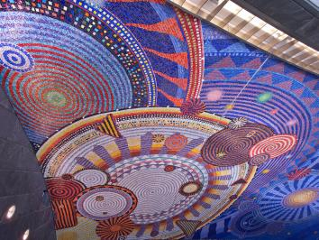 A psychedelic public artwork piece in a subway station entitled Funktional Vibrations by  Xenobia Bailey