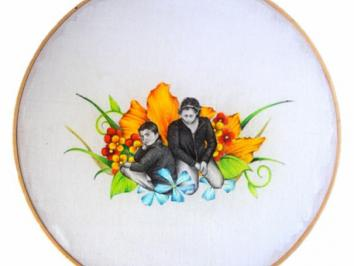 Embroidered flowers with pen and ink Latinx people on framed white fabric