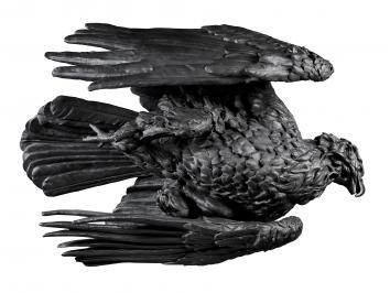 large scale metal eagle sculpture laid on its side