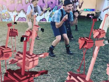 augmented reality flamingos dancing with crowd at festival