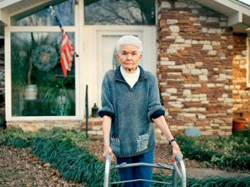 image of an elderly woman with a walker