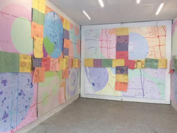 image of a room full of hand drawn maps