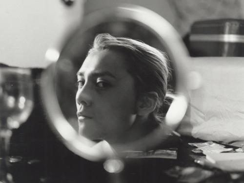 a women in profile reflect through a vanity mirror in black and white