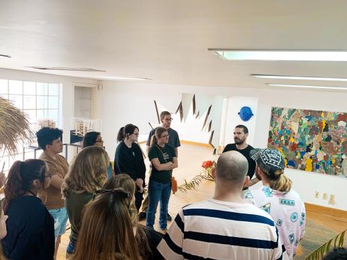 Image of University of Texas at Austin Art History class taking place in an artist's studio and immersed in Mexico City's art scene