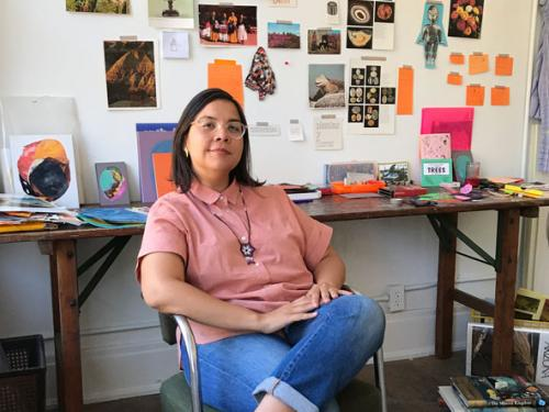 Austin based mixed media artist working in collage and UT Austin alumna Xochi Solis sits in studio and is announced as the inaugural summer start resident