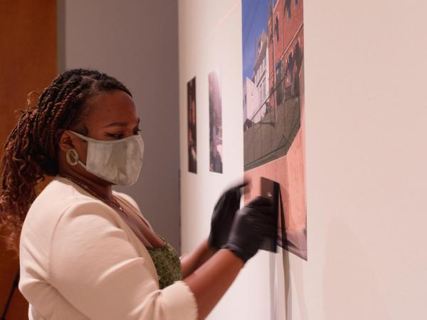 Senior Studio Art major Madison Cooper installing work for her solo exhibition curated by Center Space Project and exhibited at the Visual Arts Center