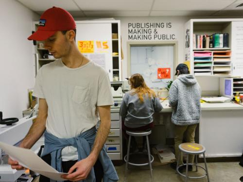 Image of the University of Texas at Austin Risograph Print Room in use by students in the Department of Art and Art History