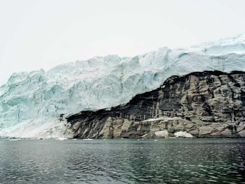 photograph of land mass in Arctic ocean