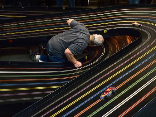 person in center of model car track