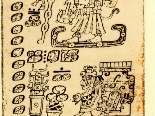 ancient codex with glyphs