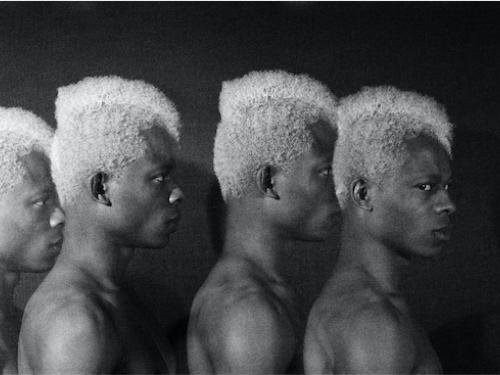 Rotimi Fani-Kayode black and white photograph titled Four Twins of four Black men in various profile orientations