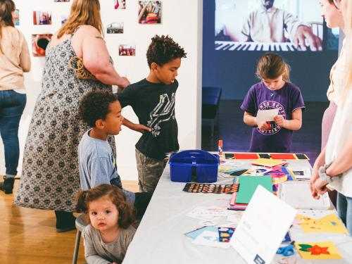 image of children participating in arts activities at UT Austin's Family Day at the VAC, the contemporary art gallery on campus