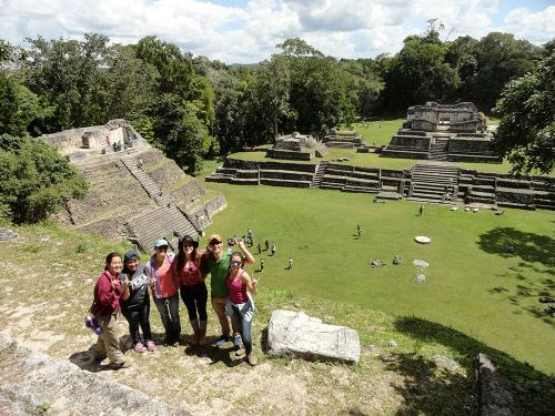 students standing on pyramid