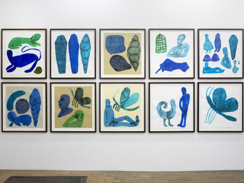 installation image of a set of ten prints stacked in two rows of five