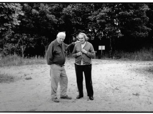 black and white image of calder and pedrosa talking together for lecture at the University of Texas at Austin