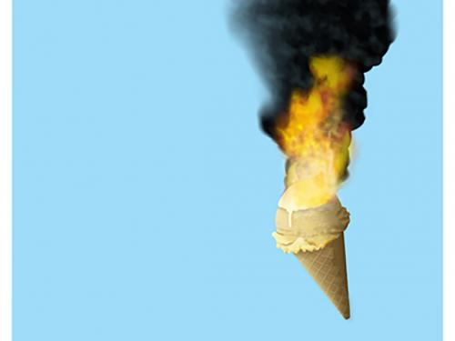 an ice cream cone on fire against blue background