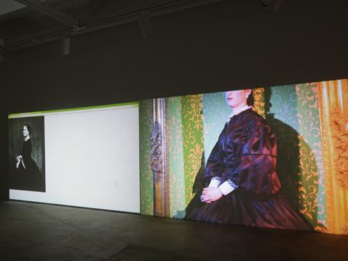video installation still of woman dressed as historical figure