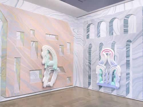 gallery installation image of lots of pastel marbleized surfaces and sculptures layered on one another