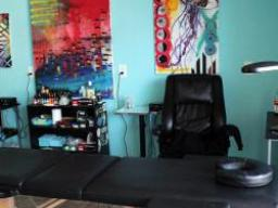 A tattoo parlor with art on the walls.